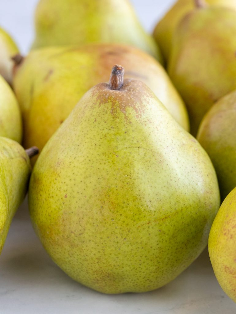 Comice pears close up on a marble surface