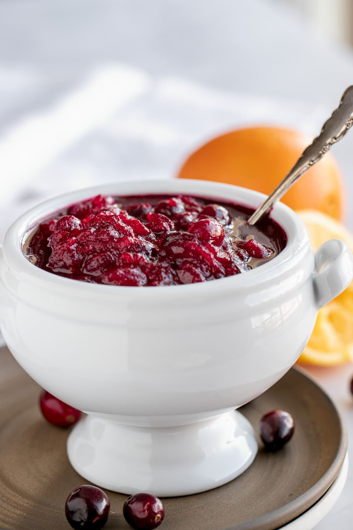 white bowl filled with fresh cranberry orange sauce