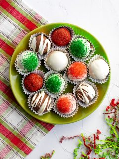 plate of assorted decorated holiday chocolate truffles