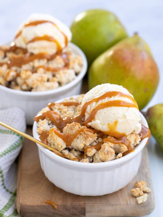 individual pear cobbler with ice cream and caramel sauce on top