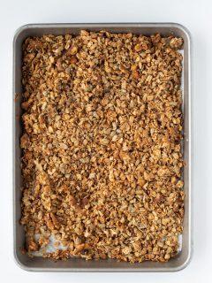 baking tray with baked honey granola homemade
