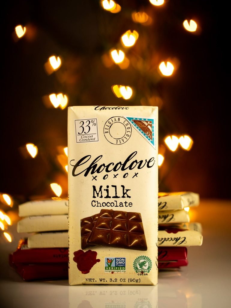 Milk chocolate Chocolove bar with heart shaped bokeh in background