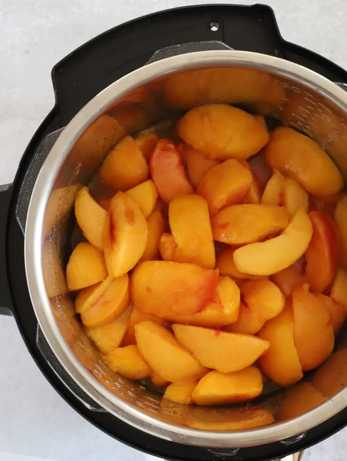 sliced and peeled peaches in an Instant Pot before cooking