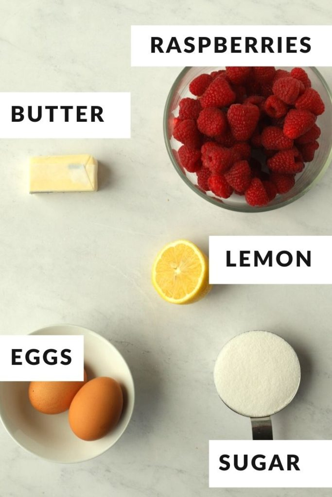 labeled ingredients of sugar, raspberries, butter, and eggs for raspberry curd