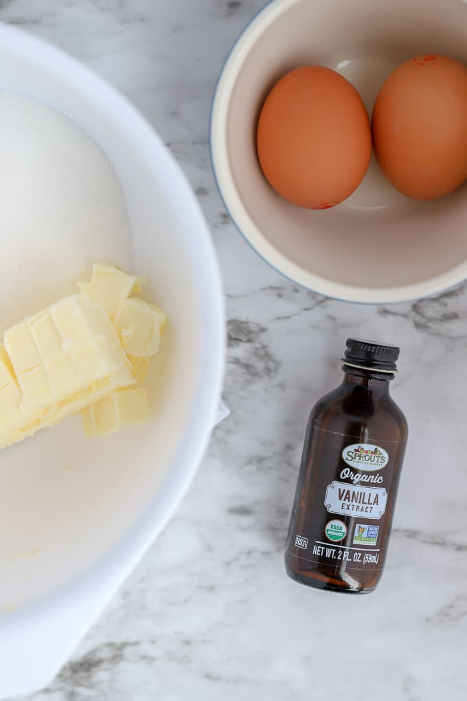 ingredients of butter, eggs and vanilla on marble surface