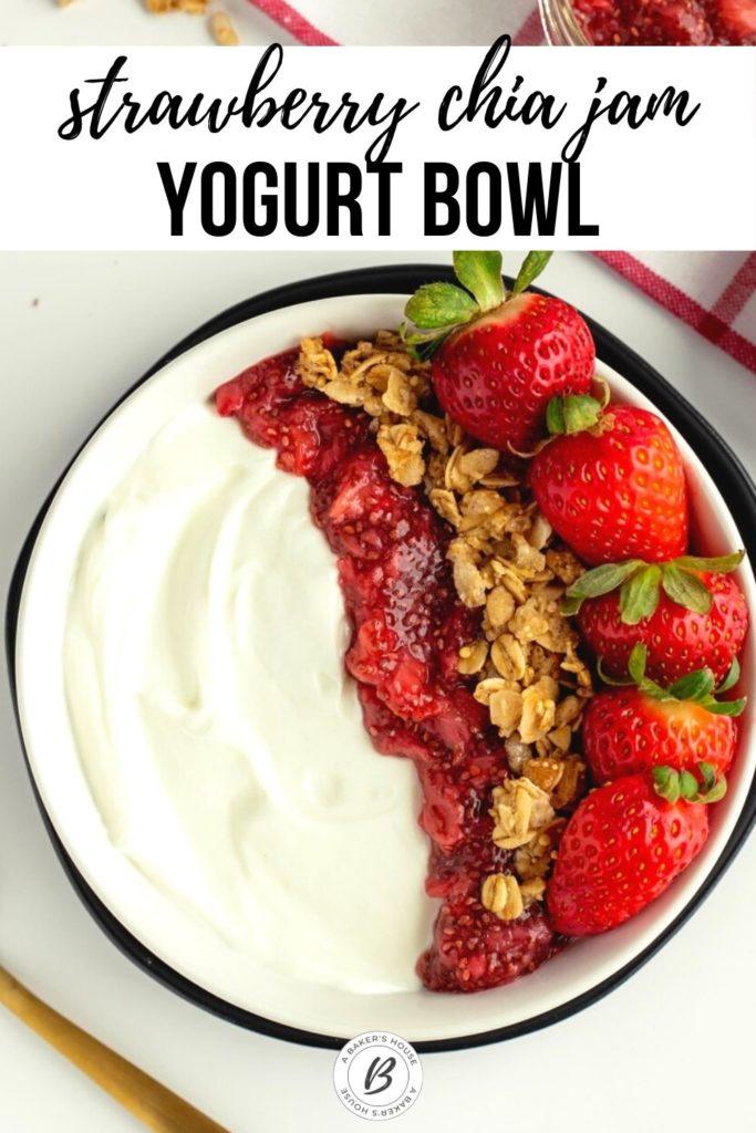 wallaby organic greek yogurt with jam, granola and strawberries in black bowl