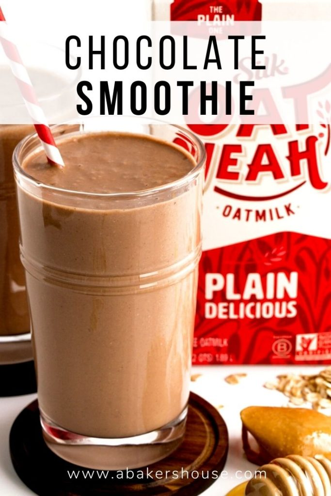 chocolate smoothie in clear tall glass with oat yeah oatmilk