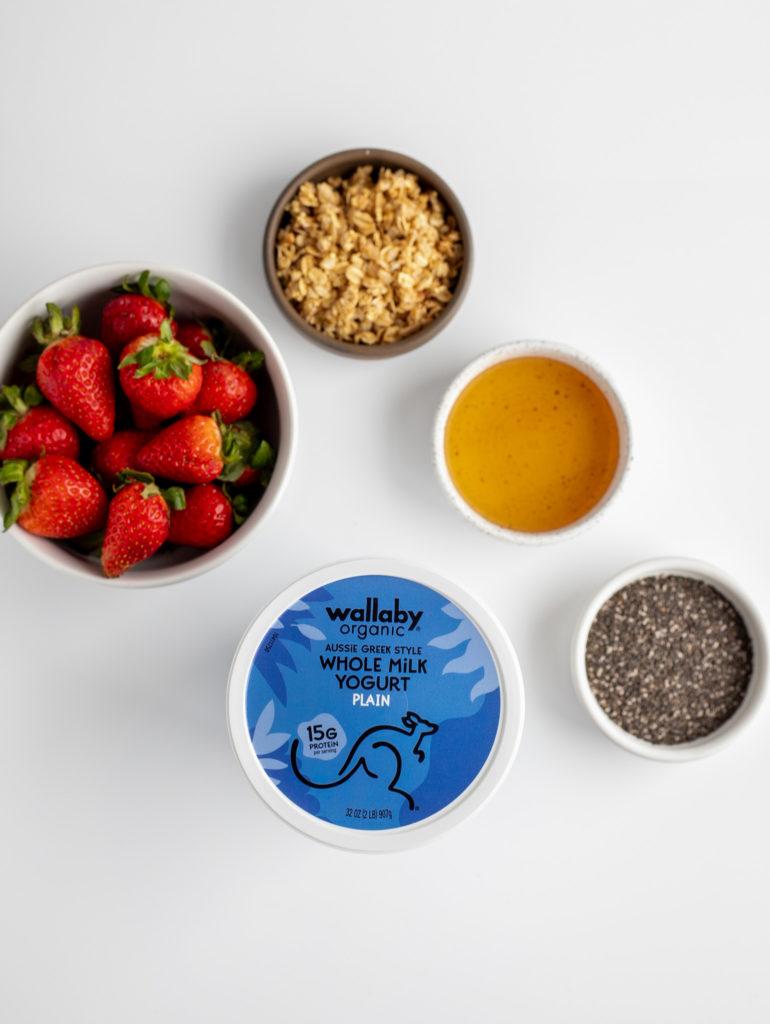 Ingredients of Greek yogurt, strawberries, chia seeds, honey and granola