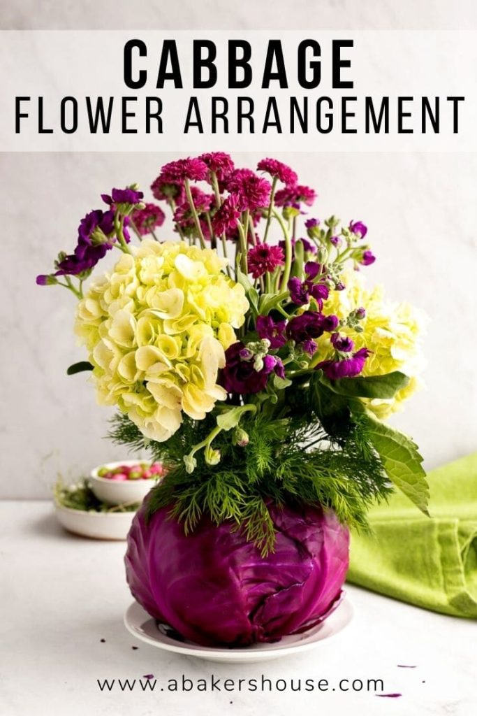 flower centerpiece in a red cabbage