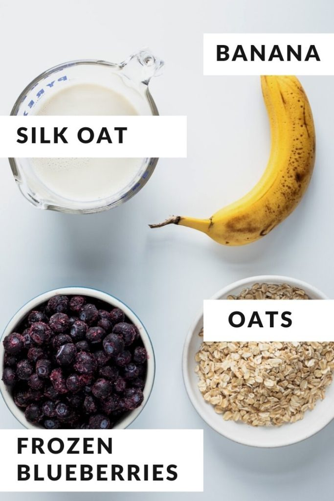 ingredients for smoothie of blueberry, banana, oatmilk and oats